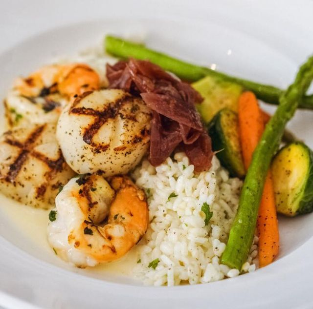 Criollo Restaurant's Grilled Shrimp and Scallops with white truffle risotto and red onion marmalade
