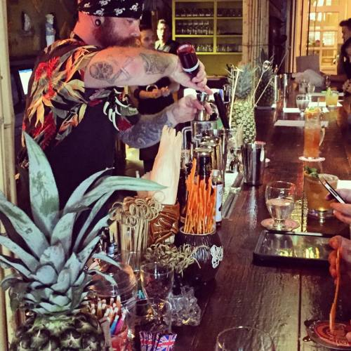 A bartender at Latitude 29 serves up authentic tiki cocktails during the restaurant's grand opening. (Photo courtesy Emery Finnegan)