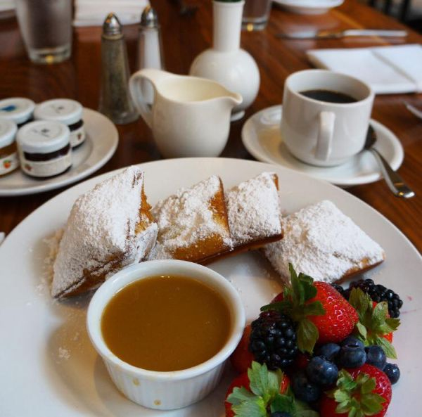 New Orleans Beignets w Praline Sauce & Strawberries at Criollo Restaurant