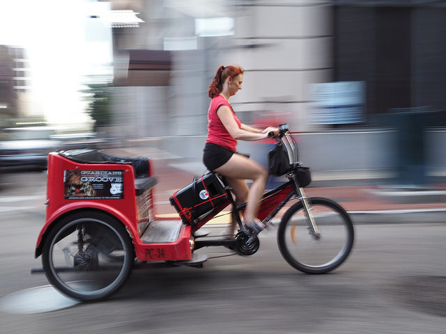 Pedicabs are a convenient way to get around the French Quarter and Marigny. (Photo courtesy via Flickr user Owen Young.)