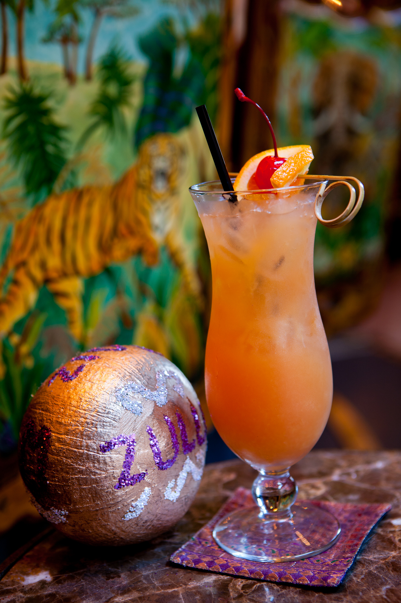 This tropical coconut punch is inspired by the world-famous Zulu Social Aid & Pleasure Club, who parade every Mardi Gras.