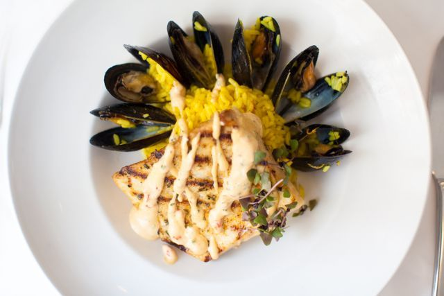 Eating at Criollo Restaurant for dinner during COOLinary? Our Grilled Cobia with Blue Mussels, Saffron Rice, and Red Pepper-Garlic Aioli is one of our delicious entrée options.