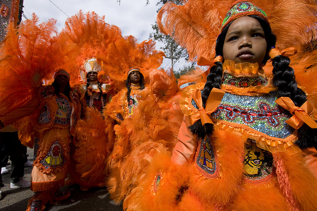 The Mardi Gras Indians traditionally meet and greet other members of their community on Super Sunday. (Photo courtesy Flickr user Derek Bridges)